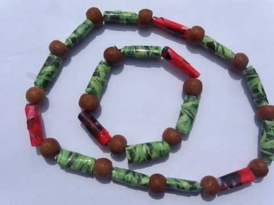 A Necklace & Bracelet set made with recycled paper beads