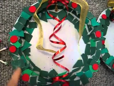 Christmas.Arts and Crafts: Colored paper, disposable plate, ribbon Wreath