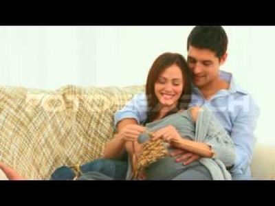 Pregnant Woman Knitting With Husband