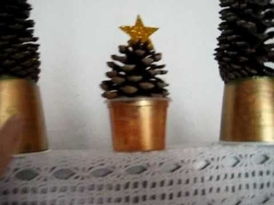 Christmas. Arts and Crafts decoration: Disposable cups, pinecones and star shapes to make trees.