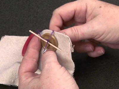 Sewing On A Four-Hole Thread Shank Button