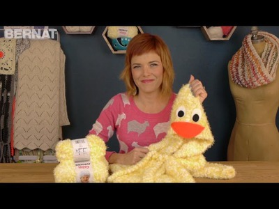 Learn to knit a duck robe using Bernat Happy Yarn