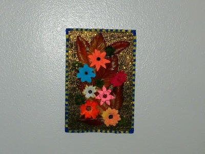 Recycled DIY: Cardboard wall frame decorated with dry leaves and flowers made with snack box cover!