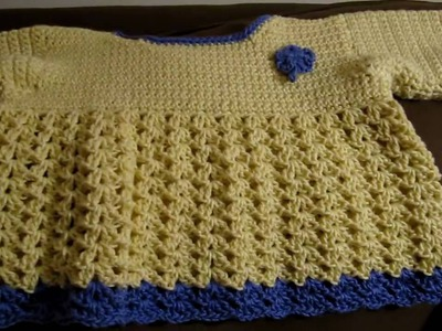 Crochet child's sweater with Teresa's crochet round pouch