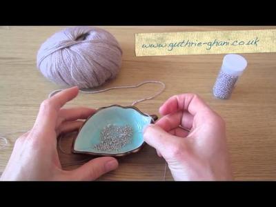 How to thread beads onto yarn
