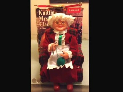 Mrs Claus singing and knitting