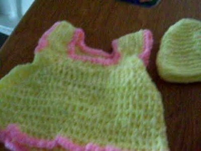 A Crochet Baby Dress And Hats