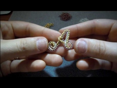 DIY - Tutorial - ciondolo wire rivestito di perline e news.wmv
