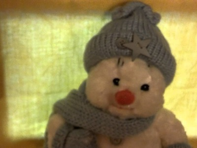 Snowman with Knitted hat, scarf and mittens