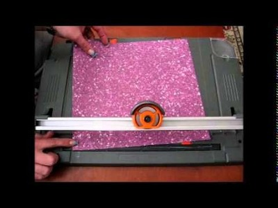 Using a paper cutter to make strips for paper beads