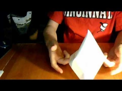 How to make an origami sailor hat.canoe boat