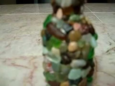Miniature glass bottle decorated with tiny sea pebbles and sea glass gems diy craft