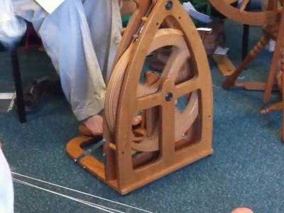 Judith Mackenzie spinning cashmere.silk from a cotton carder