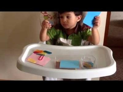 Moksh in a Montessori Practical Life Activity with paper pins. U Pins (DIY Activity)