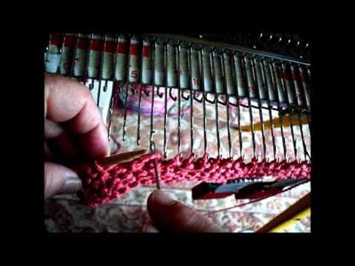 Combining hand and machine knitting  hanging garter stitch on the knitting machine