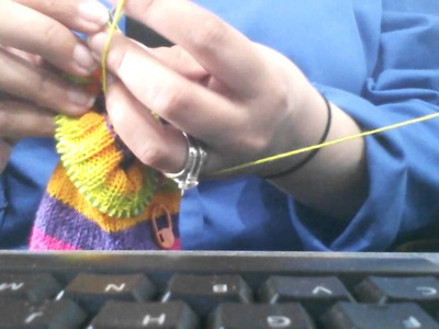 "Knitting on 9""circular needles, how I hold them"