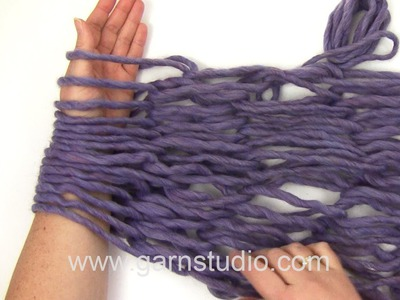 DROPS Knitting  Tutorial: How to Arm Knit.