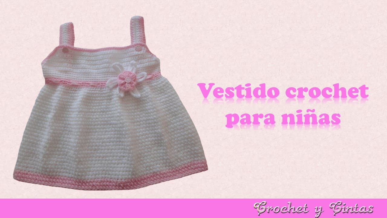 Vestido con flor tejido a crochet para niña