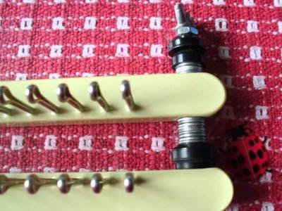 Adjusting gauge on double knitting boards.wmv