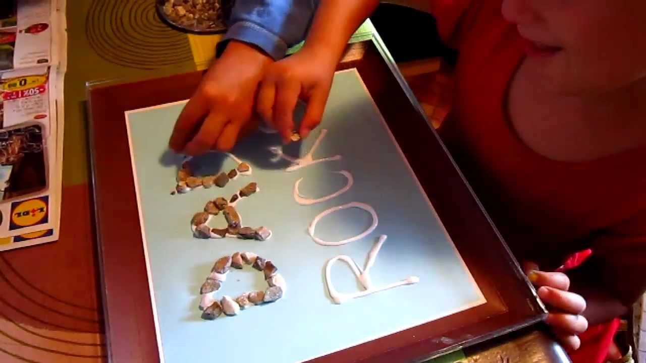 """Arts and Crafts project, to make for Father's Day: A """"Dad Rocks"""" poster with small pebbles."""