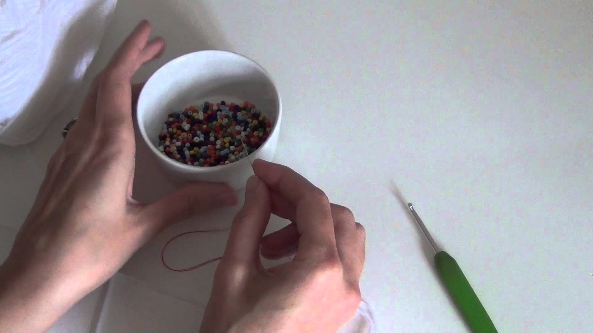 How to thread seed beads onto yarn