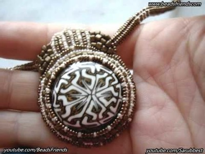BeadsFriends: Bead embroidery necklace - A polymer clay cabochon pendant surrounded with beads