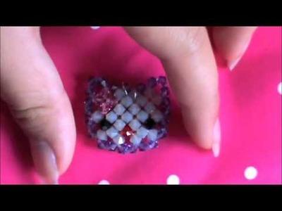 A charm made out of swarovski beads