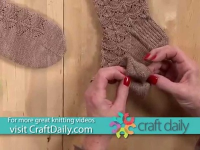Knit Socks with a Rounded Chevron Stitch and Scalloped Edge