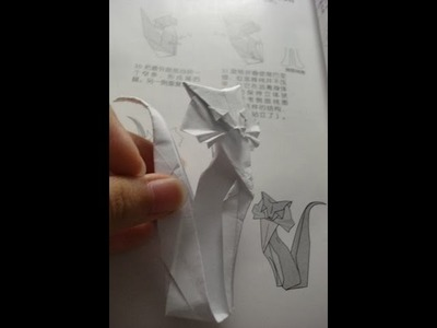 Origami cat instruction designed by Roman Diaz
