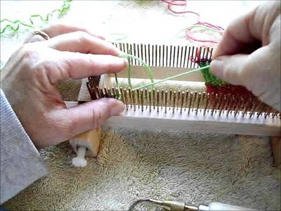 Long tail cast on performed on fine gauge fixed KISS loom