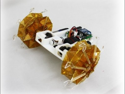 Origami wheel robot base on magic-ball origami structure