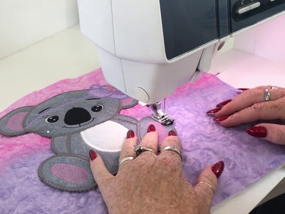 How to stitch a completed Large Applique Design to an item