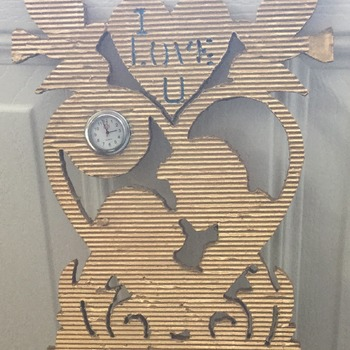 I LOVE YOU Clock, made from cardboard, painted gold, with a small nurses watch inserted into the cardboard