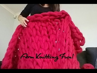 Arm Knitting A Blanket With Giant Balls Of Merino Wool