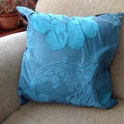 Black velvet cushion with floral print design and turquoise back