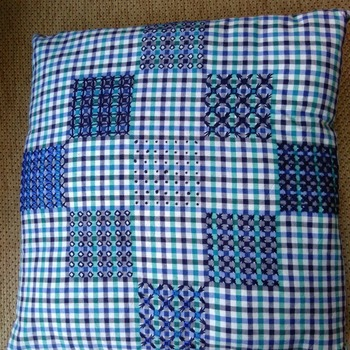 Blue gingham cushion with blackwork embroidery