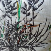 Cotton beige cushion with embroidery flower detail on drawn sketch
