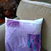Cotton cushion in purple dip dye with applique embellishment