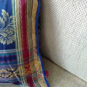 Damask blue cushion with piped edging