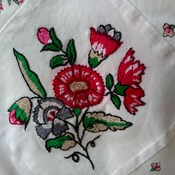 Floral patterned cushion with hand embroidered panel
