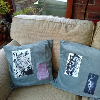 Pair of green velvet cushions with abstract applique embellishment