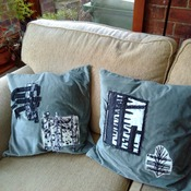 Pair of green velvet cushions with applique embellishment