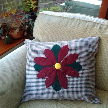 Wool check cushion in red & green with flower applique