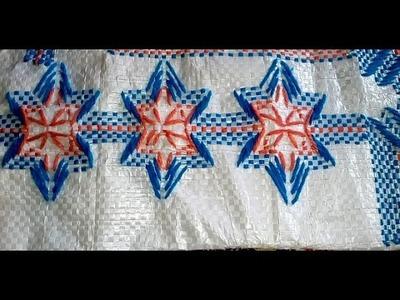 Star design on plastic Sack. Table mat stitch on plastic Sack. Hand embroidery. Door mat stitch.