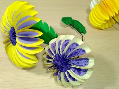 Paper flower from circles in origami style.