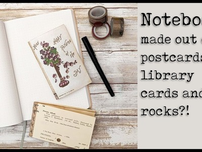 Notebooks made out of postcards, library cards and.  rocks?!