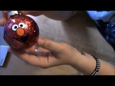Applying vinyl to a round surface layered Elmo sesame Street ornament for christmas