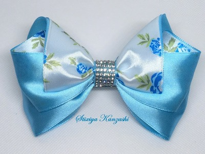 The decoration on the hairpin Kanzashi. Blue bow with roses
