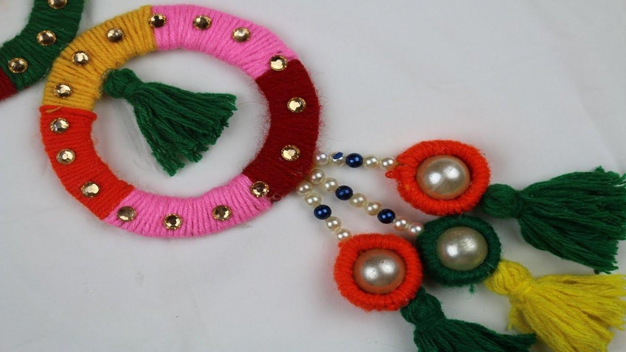DIY arts and crafts   How to Make Door Hanging Toran For Room Decor - Amazing Woolen Craft Idea