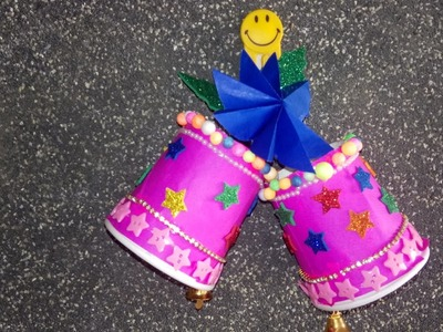 Christmas bell making using paper cup for wall decoration. Christmas decorations.